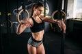 Slim female athlete exercise on gymnastic rings Royalty Free Stock Photo