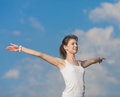 Slim girl does morning exercises attractive young woman in white outdoors Royalty Free Stock Photography
