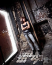 Slim girl posing at porch in old abandoned building Stock Photography