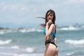Slim girl in rear view wear bikini and walking on sandy beach Royalty Free Stock Photo