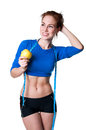 Slim happy woman sporty young model wearing blue top and black shorts holding ripe apple measuring her waist with ruler tape Stock Photography