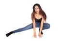 Slim woman crouching on the floor Royalty Free Stock Photo