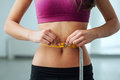 Slim woman measuring her thin waist Royalty Free Stock Photo