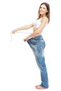 Slim woman in oversize jeans weight loss concept Stock Photography
