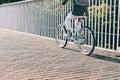 Slim woman rides a city bike Royalty Free Stock Photo