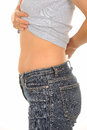 Slim woman showing stomach Royalty Free Stock Image