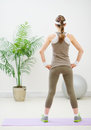Slim woman standing back to camera Royalty Free Stock Photo
