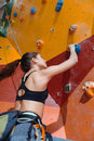 Slim woman training hard in climbing gym Royalty Free Stock Photo