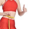 Slim woman waist measuring sporty by tape after fitness isolated on white attractive young hand ok sign Royalty Free Stock Image