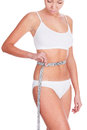 Slim woman in white underwear with tape measure copyspace Stock Photography