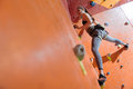 Slim young woman training hard in climbing gym Royalty Free Stock Photo
