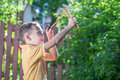 Slingshot young boy with shooting Royalty Free Stock Photos