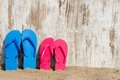 Slippers on the beach weathered wood and some Royalty Free Stock Images