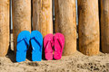 Slippers on the beach weathered wood and some Royalty Free Stock Image