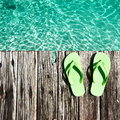 Slippers at jetty by the sea Royalty Free Stock Images
