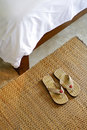 Slippers and part of blanket hospitality concept with detail Royalty Free Stock Image