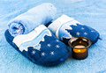 Slippers with towels and candle Stock Images
