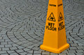 Slippery floor surface warning sign Royalty Free Stock Photo