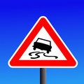 Slippery road sign Stock Photo
