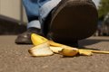 Slipping on a banana peel person about to slip or skin Stock Photo