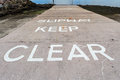Slipway a with a keep clear message Stock Photography
