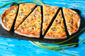 Slised vegeterian home made pizza mushrooms on blue table Royalty Free Stock Photo