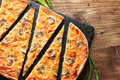 Slised vegeterian home made pizza with mushrooms. Top view on wooden table Royalty Free Stock Photo