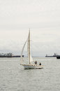Sloop sail boat in long beach harbor a coasts along the calm waters of Stock Image