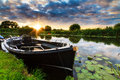 Sloop sunset modern and luxurious synthetic motor in a river in the netherlands at Stock Photos