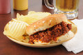 Sloppy Joe and potato chips Stock Image
