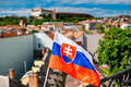 Slovak flag on Bratislava city background