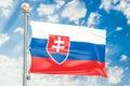 Slovak flag waving in blue cloudy sky, 3D rendering