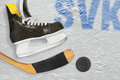 Slovak hockey stick, skates and the puck on the ice Royalty Free Stock Photo