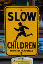 Slow children street sign yellow Stock Images