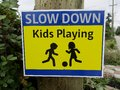 Slow down. Kids playing traffic sign. Royalty Free Stock Photo