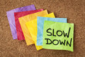 Slow down lifestyle concept or advice handwriting on colorful sticky notes Stock Image