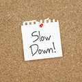 Slow down message on corkboard Stock Photography