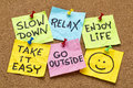 Slow down relax take it easy enjoy life motivational lifestyle reminders on colorful sticky notes Stock Images