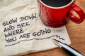 Slow down and see on napkin where you are going motivational reminder handwriting a with a cup of coffee Stock Images