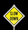 Slow down yellow road sign isolated over black clipping path included Stock Images