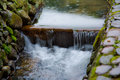 Slow shutter blend of small river in wild forest in china creek Royalty Free Stock Image