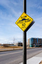 Slow Speed Bump Road Sign on Residential Street Royalty Free Stock Photo