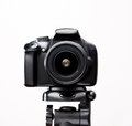SLR camera on a tripod close-up Royalty Free Stock Photo