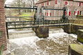 Sluice with running water spill at grote koppel amerfoort the netherlands on january Royalty Free Stock Photography