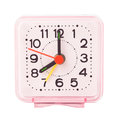 Small alarm clock in plastic case isolated on white background Stock Photo