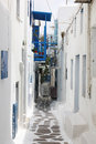 Small alley of mykonos a in the town fira on the island greek with the copestone street and the white houses Royalty Free Stock Images