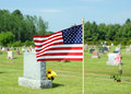 Small American flag waving in cemetery Royalty Free Stock Images
