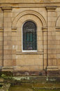 Small arched window of an early nineteenth century mansion georgian period Royalty Free Stock Images
