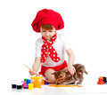 Small artist child painting. Kitten sitting near Royalty Free Stock Photo