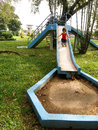 Small asian girl on old play ground Royalty Free Stock Photo